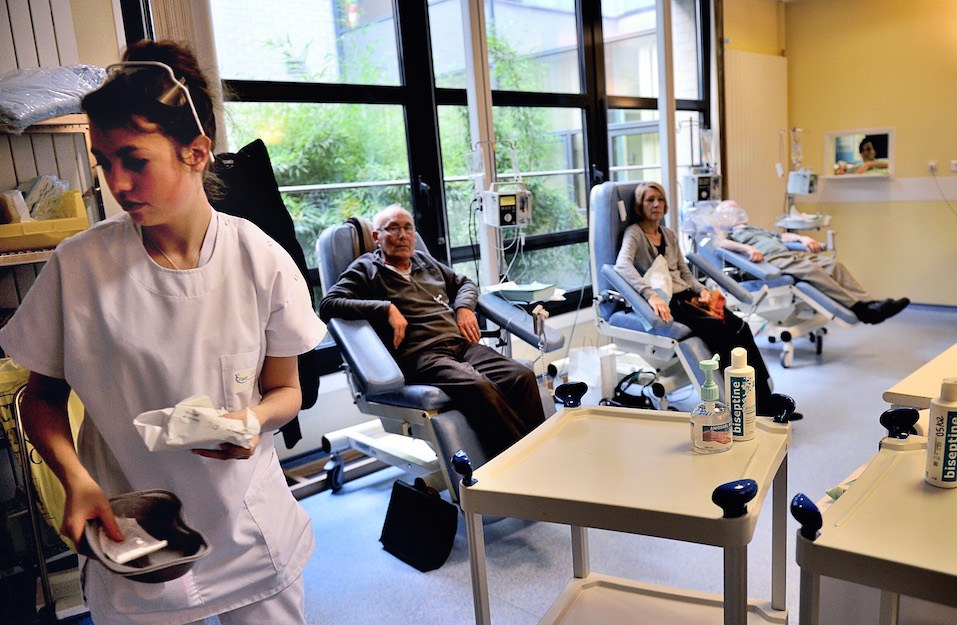 A nurse is working in a room where patients undergo chemotherapy treatment