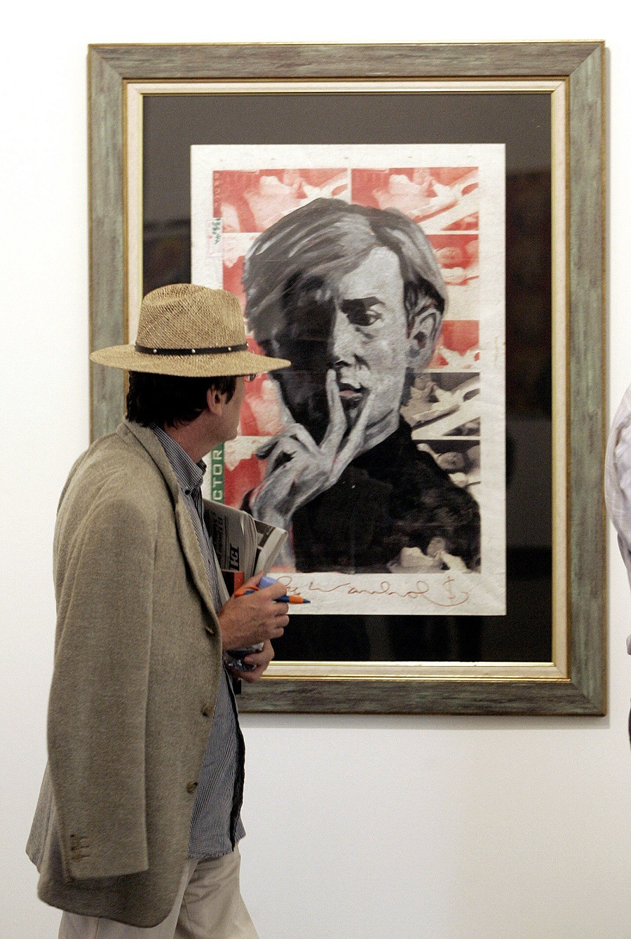 man looking at the painting