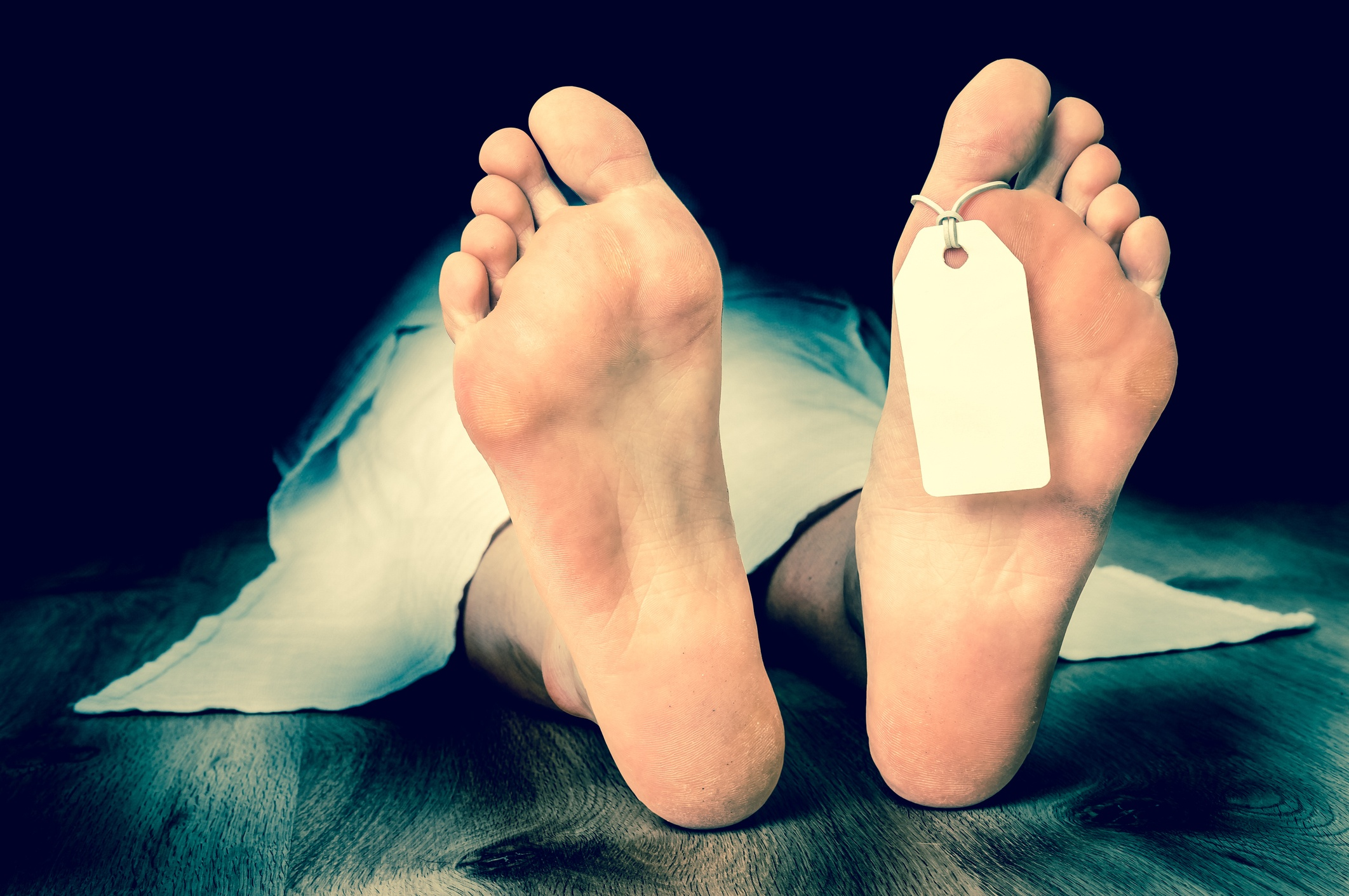 Dead woman with blank tag on feet