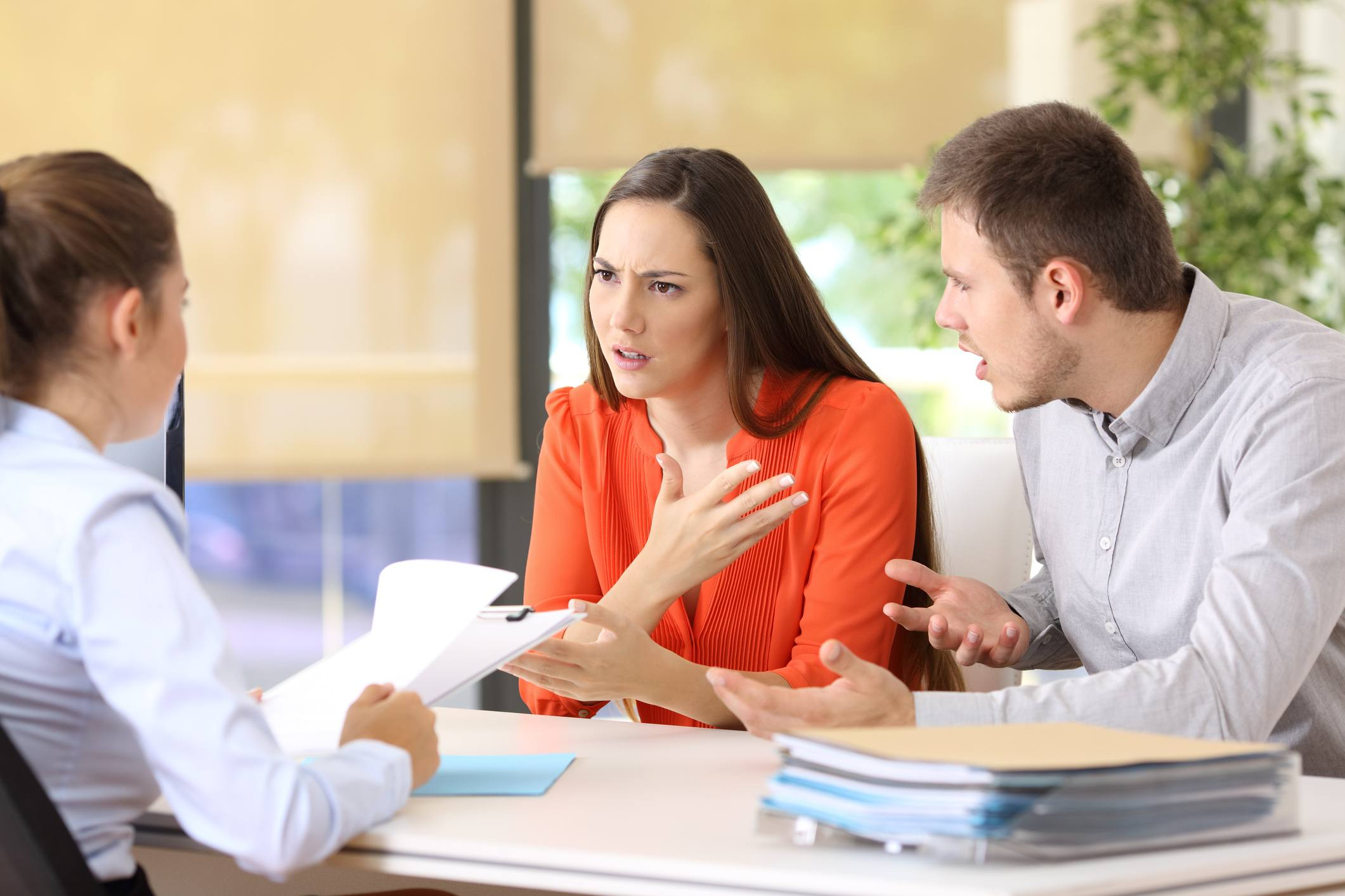 Couple arguing in a marriage counseling or divorce proceedings