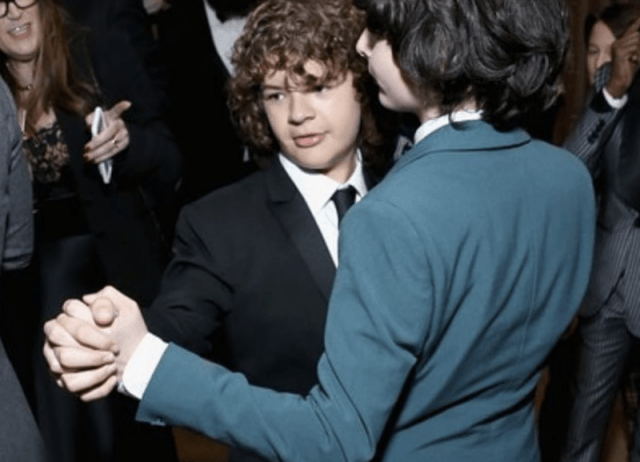 Gaten and Finn dancing at a party.