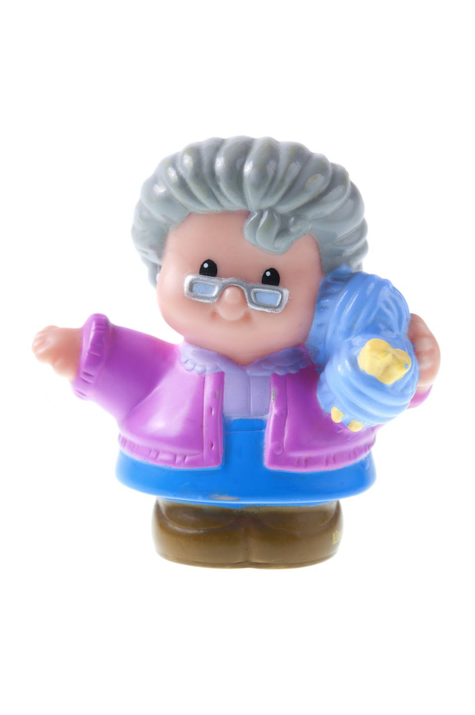 A studio shot of a Fisher Price Little People Grand Mother