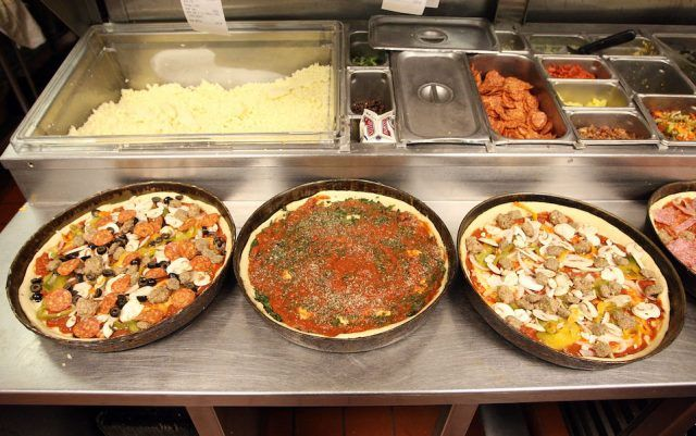 Deep dish pizzas are prepared at Connie's Pizza
