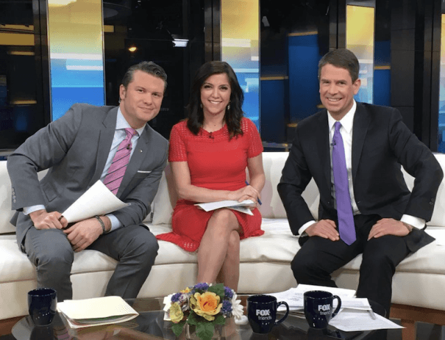 The cast of 'Fox and Friends' sitting on the curvy couch.