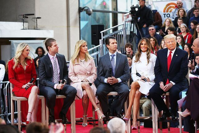 Donald Trump sits with his wife Melania Trump and from left: daughter Tiffany, son Eric, daughter Ivanka and son Donald Trump Jr. while appearing at an NBC Town Hall.