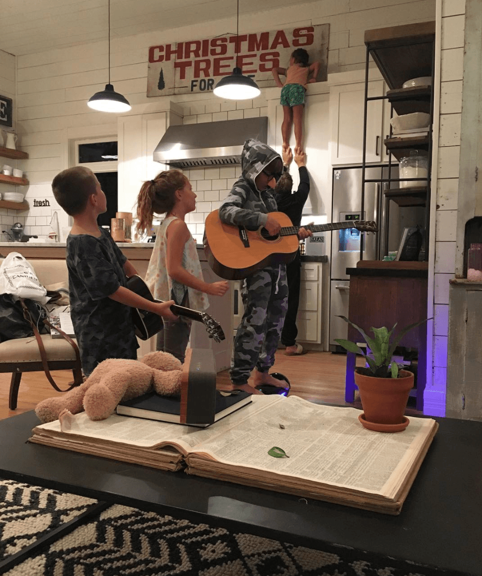 Gaines kids playing guitar