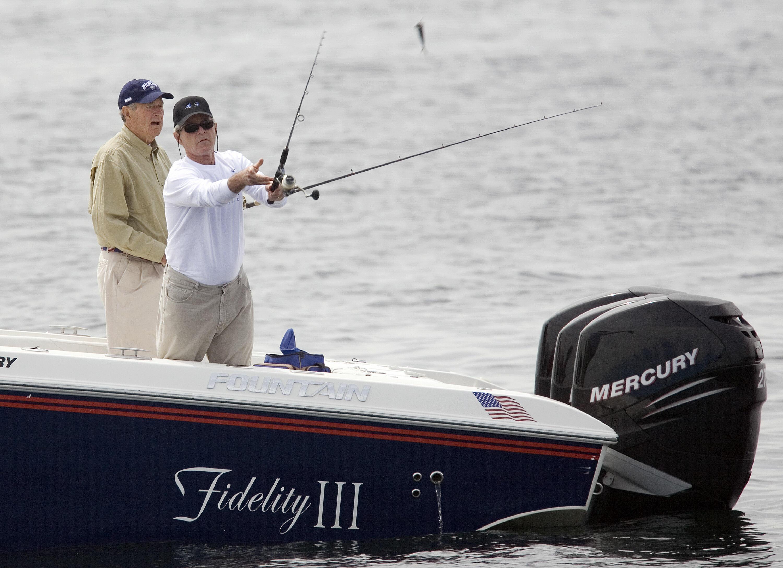 US President George W. Bush (R) and former president George HW Bush