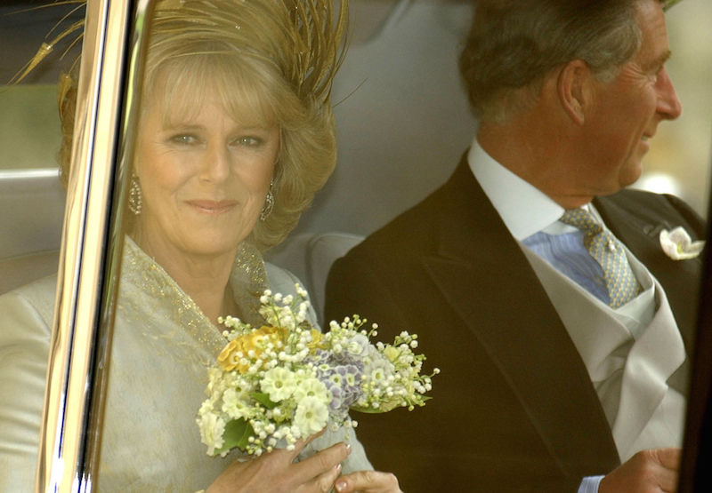 Prince Charles and Camila Parker Bowles in the backseat of a car.