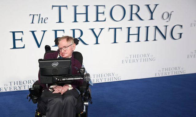 Stephen Hawking sitting in front of a tablet during a presentation.