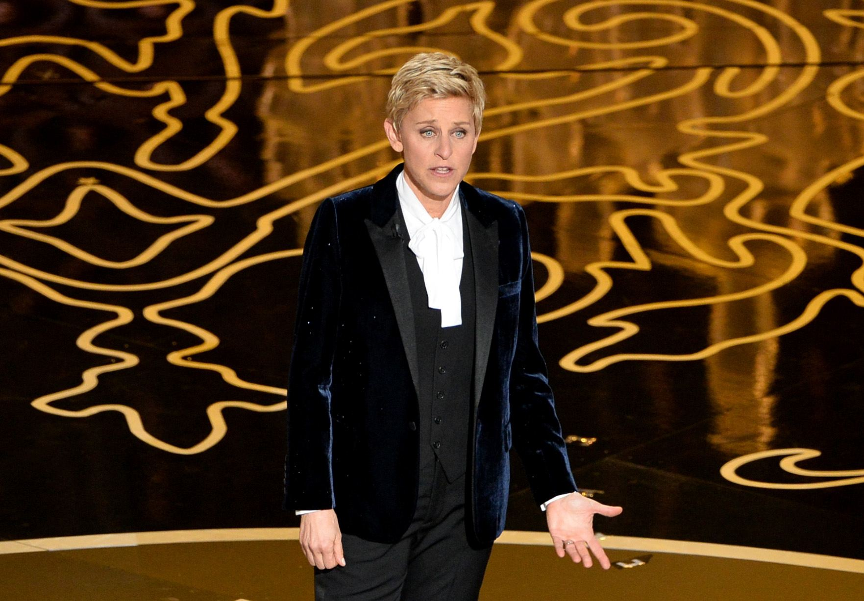 Host Ellen DeGeneres speaks onstage during the Oscars at the Dolby Theatre on March 2, 2014 in Hollywood, California.