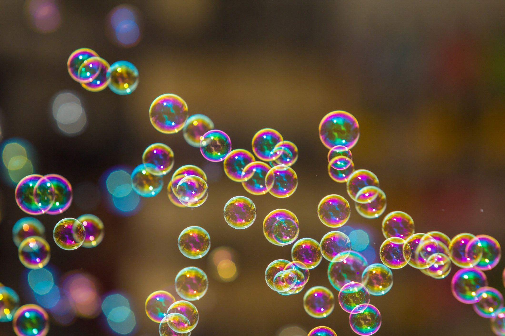 The rainbow soap bubbles from the bubble blower.