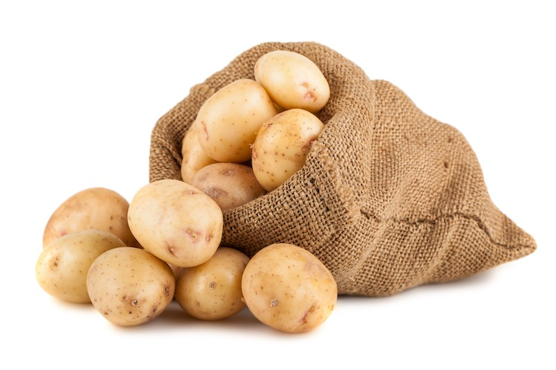 A sack of potatoes against a white background