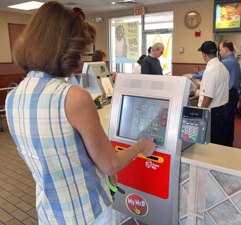 woman using a McDonald's kiosk