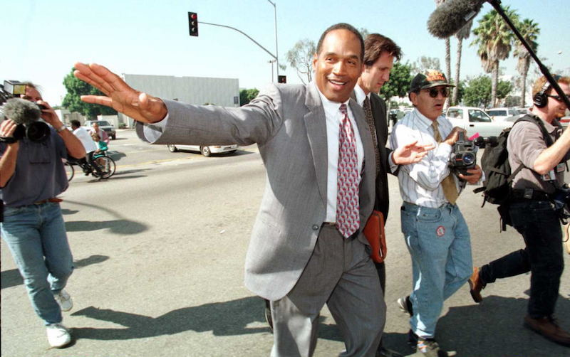 O.J. Simpson crosses the street from the courthouse in Santa Monica, California during a lunch break