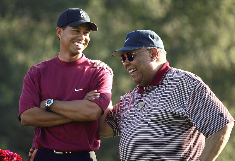 THOUSAND OAKS, CA - DECEMBER 12: Tiger Woods (L) smiles as he stands with his father, Earl Woods, during the trophy presentation of the Target World Challenge on December 12, 2004 at Sherwood Country Club in Thousand Oaks, California. Woods won the event at 16 under par. (Photo by Doug Benc/Getty Images)