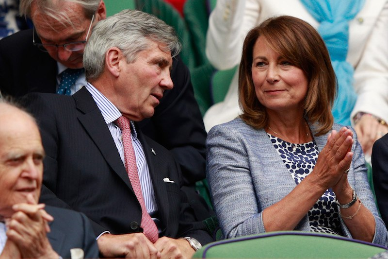 LONDON, ENGLAND - JUNE 30: The Parents of Kate Middleton, Michael and Carole Middleton are in conversation as they watch on from the stands in centre court on day four of the Wimbledon Lawn Tennis Championships at the All England Lawn Tennis and Croquet Club on June 30, 2016 in London, England. (Photo by Adam Pretty/Getty Images)