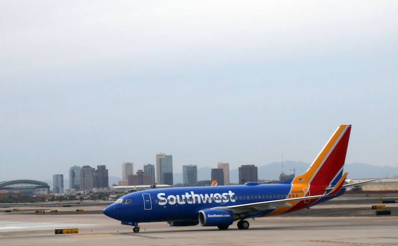 A Southwest airline plane is seen on the tarmac at Phoenix Sky Harbor International Airport on September 19, 2016 in Phoenix, Arizona. / AFP / Daniel SLIM (Photo credit should read DANIEL SLIM/AFP/Getty Images)