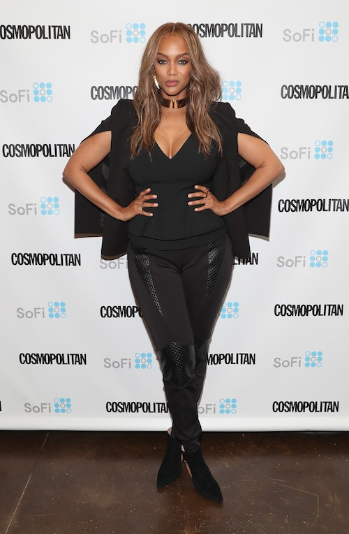 Tyra Banks posing on a red carpet.