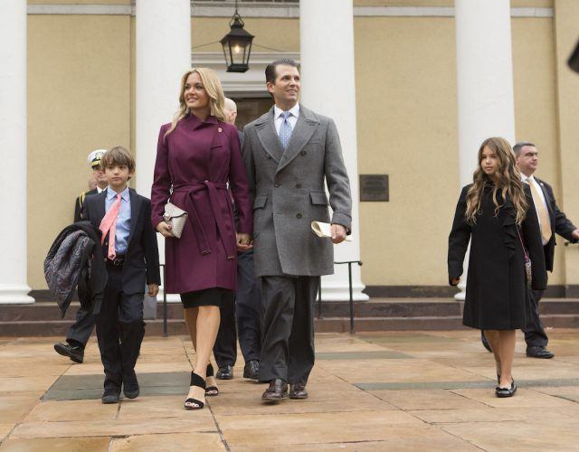 Vanessa and Donald Trump Jr walking together with their children.