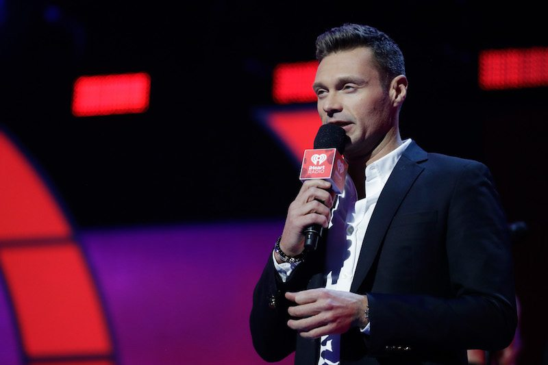 LAS VEGAS, NV - SEPTEMBER 23: Ryan Seacrest speaks onstage during the 2017 iHeartRadio Music Festival at T-Mobile Arena on September 23, 2017 in Las Vegas, Nevada. (Photo by Isaac Brekken/Getty Images for iHeartMedia)