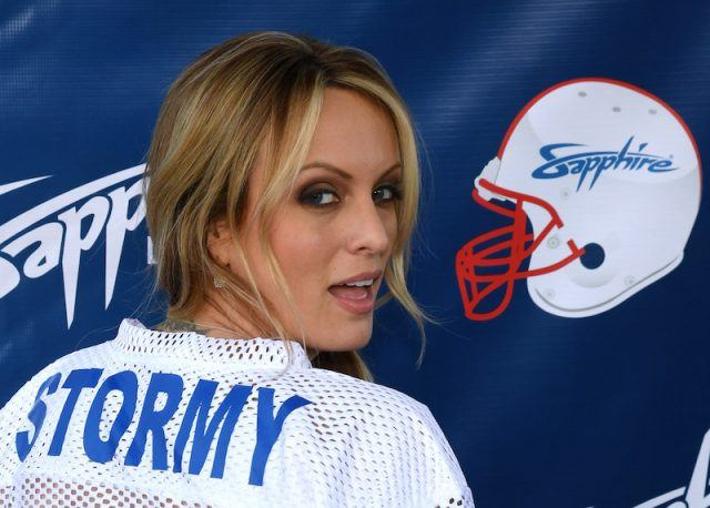 Stormy Daniels wearing a blue and white jersey.
