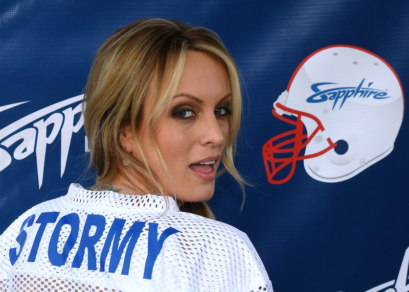 Stormy Daniels wearing a white and blue jersey.