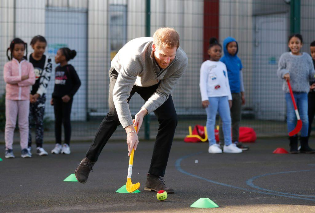 Prince Harry playing games with kids from a school