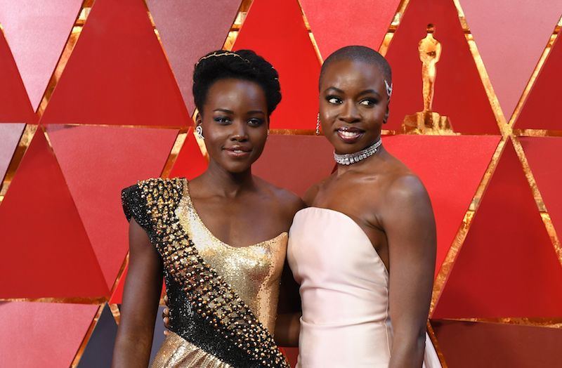 Kenyan actress Lupita Nyong'o (L) and US actress Danai Gurira arrive for the 90th Annual Academy Awards on March 4, 2018, in Hollywood, California. / AFP PHOTO / ANGELA WEISS (Photo credit should read ANGELA WEISS/AFP/Getty Images)