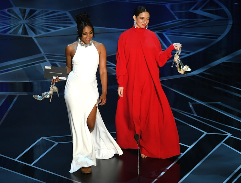 HOLLYWOOD, CA - MARCH 04: Actors Tiffany Haddish (L) and Maya Rudolph walk onstage during the 90th Annual Academy Awards at the Dolby Theatre at Hollywood & Highland Center on March 4, 2018 in Hollywood, California. (Photo by Kevin Winter/Getty Images)