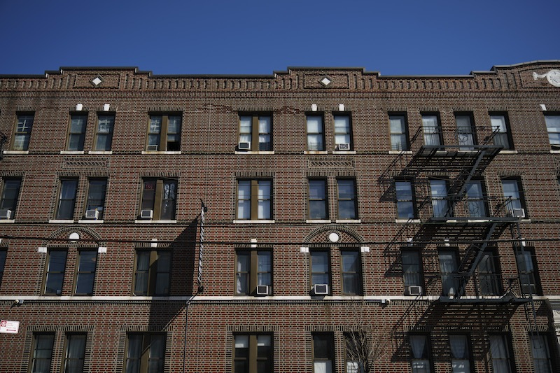 An apartment building formerly owned by the Kushner Companies, run by the family of White House senior adviser Jared Kushner, stands in the Astoria neighborhood of Queens, March 19, 2018 in New York City. In dozens of rental buildings across New York City, the Kushner Companies filed false paperwork declaring that the buildings had zero rent-regulated tenants. The move allowed the company to push out rent-controlled tenants, raise rents and boost profits when it later sold the buildings.