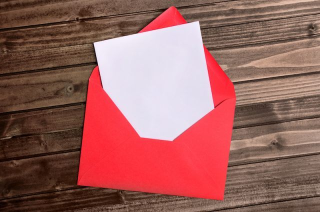 A blank greeting card in an envelope.