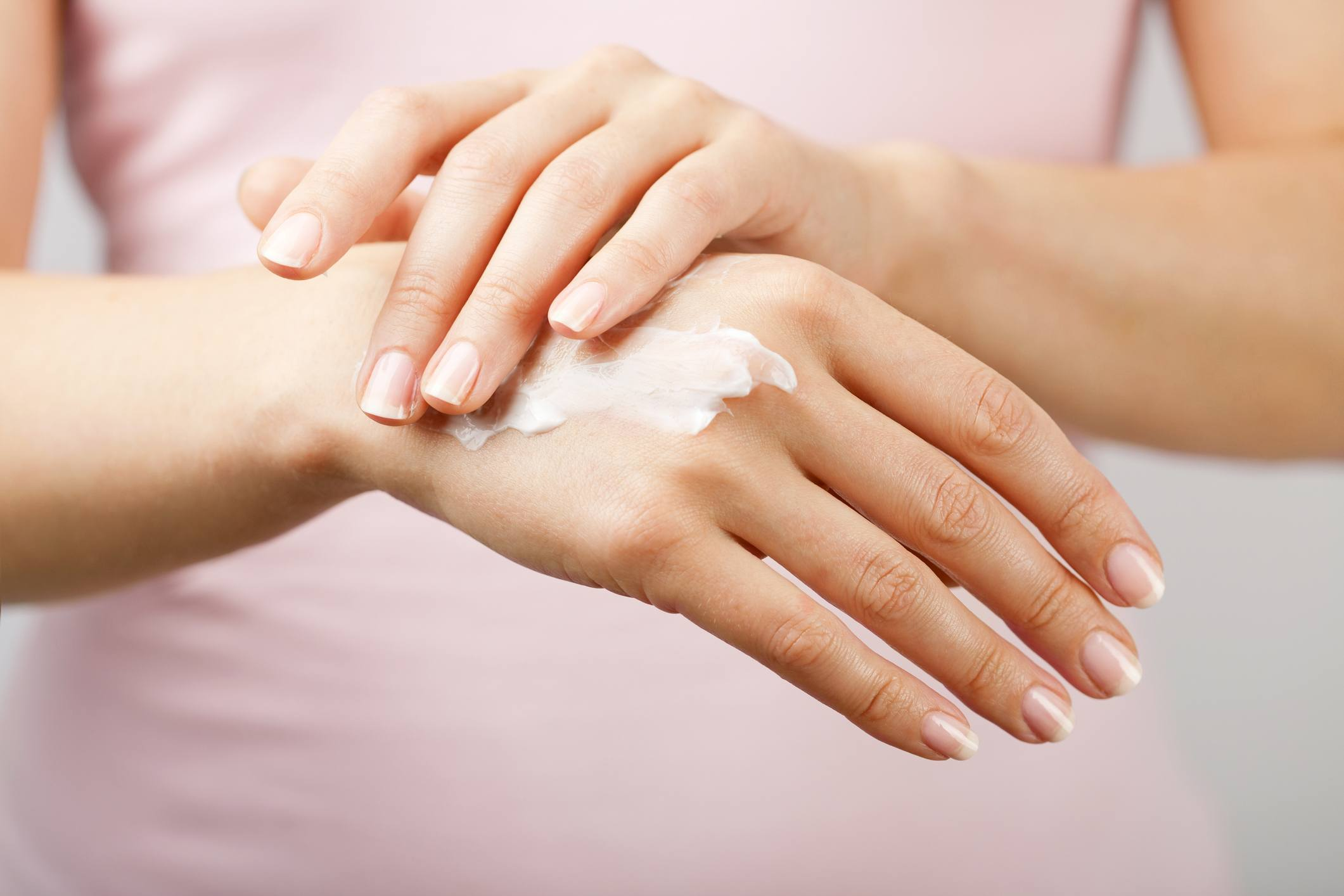 Moisturizing cream being rub into skin on hands