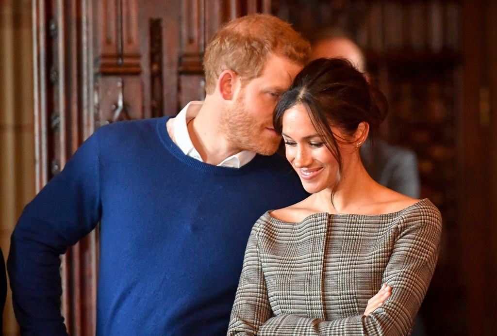 Prince Harry whispers in Meghan Markle's ear