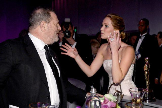 Harvey Weinstein and Jennifer Lawrence speaking to each other.