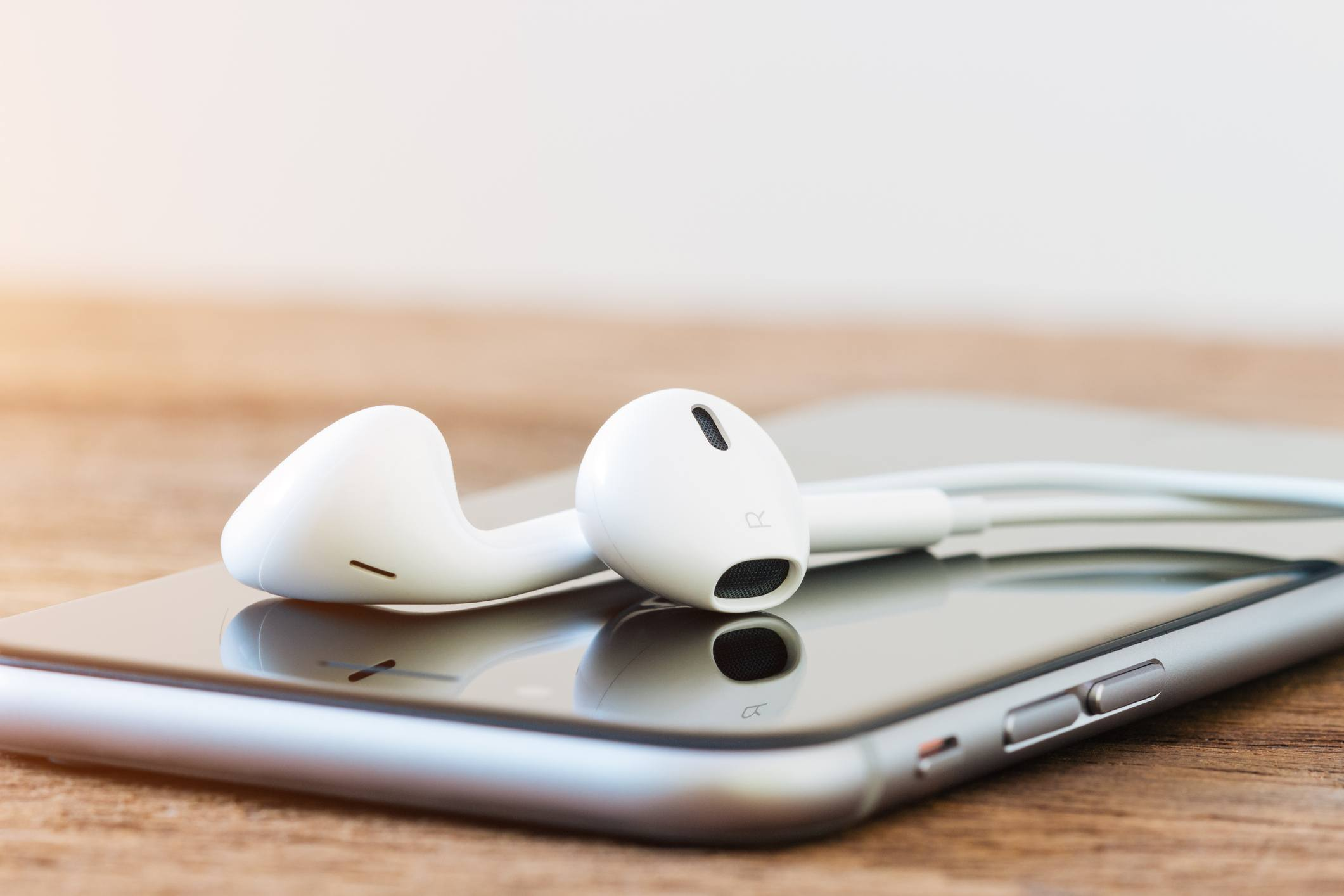 closeup iphone and earphones or headphones device on table