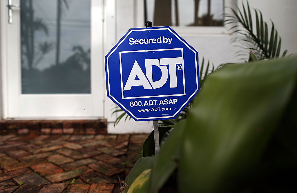 ADT home security sign in front of window