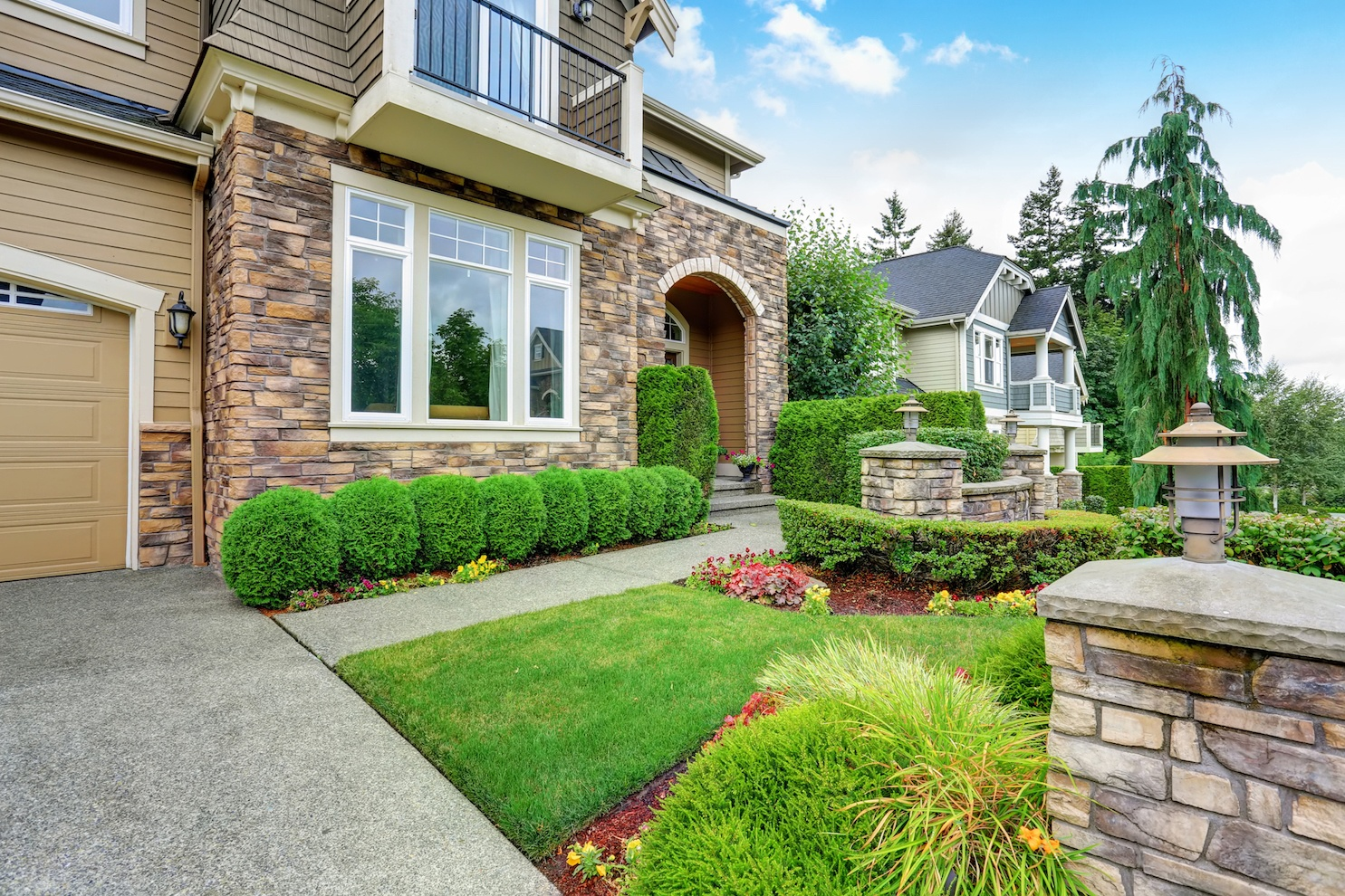 Beautiful curb appeal of American house with stone trim