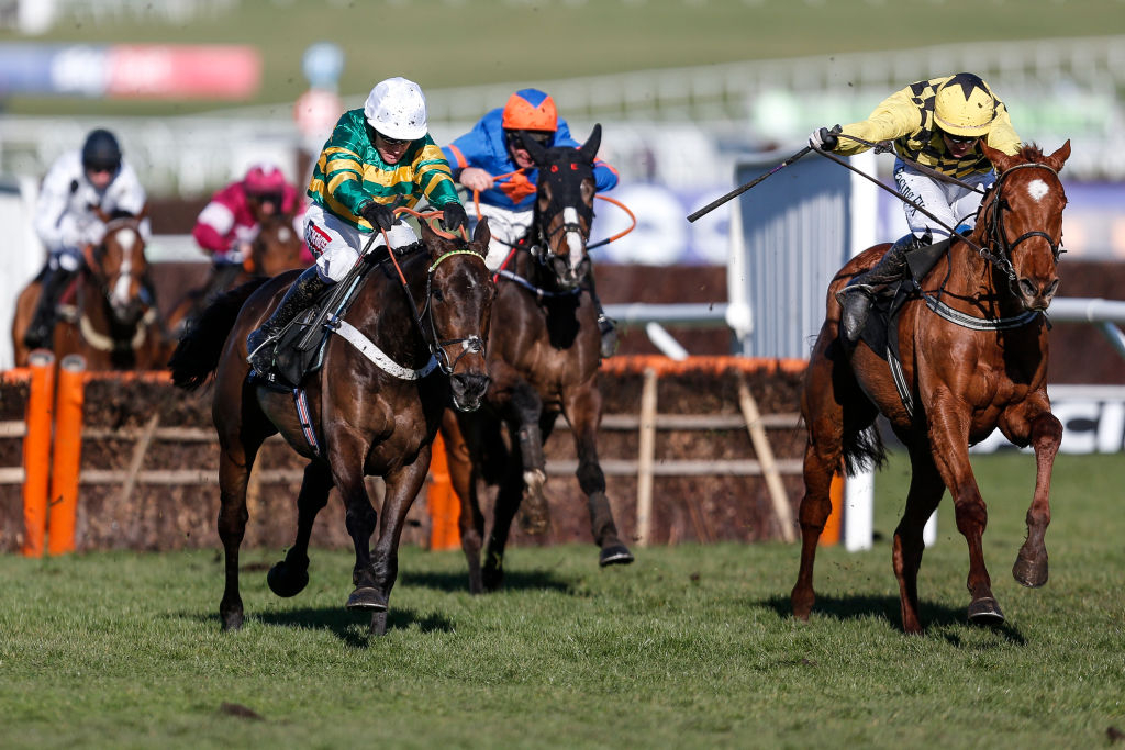 Three horses and riders during race