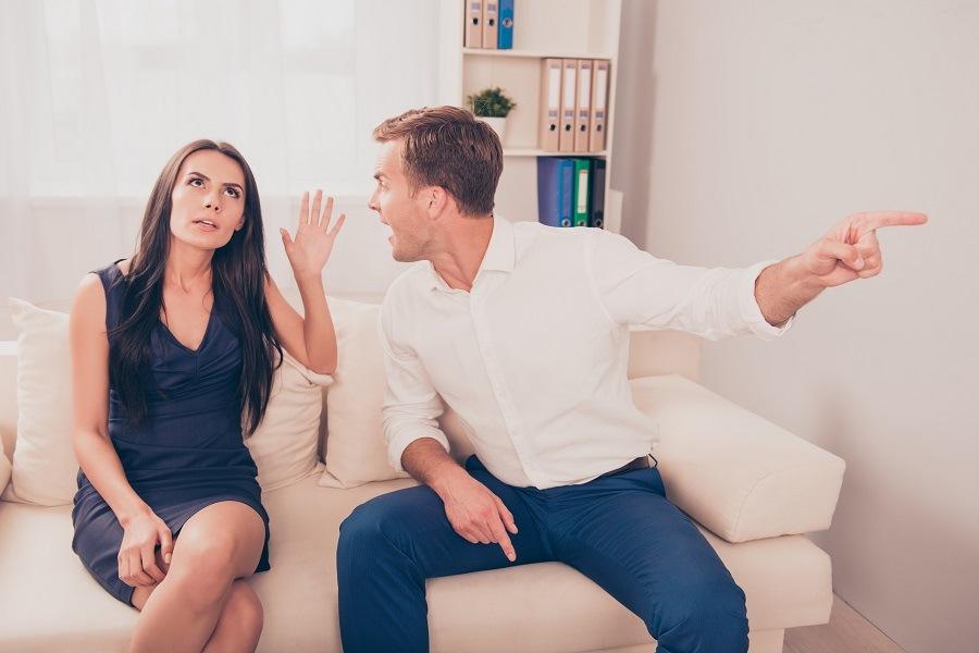 man and woman quarreling