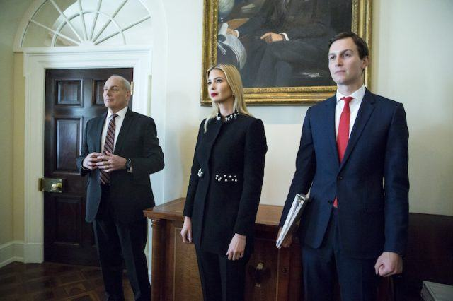 Ivanka and Jared standing together in front of a painting.