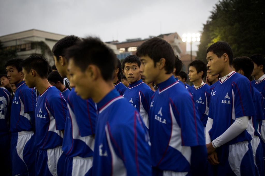 students attend a football training session at Tokyo Korean high school