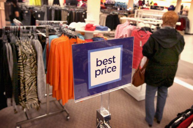 A sign displays a new pricing stategy at a JCPenney store