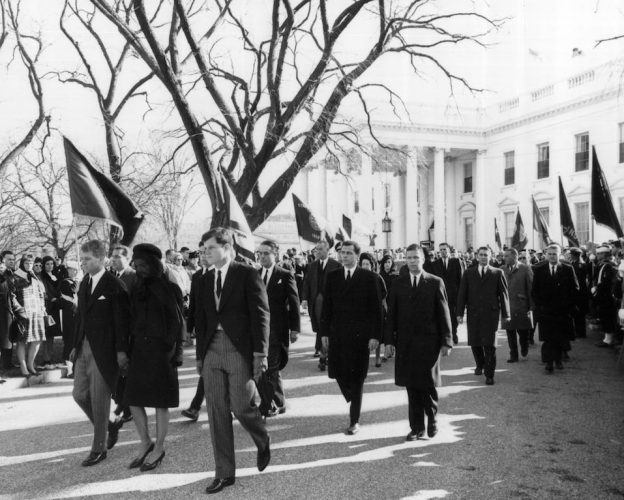 Robert and Edward Kennedy escort Jackie Kennedy from the White House to attend the funeral of President John F. Kennedy