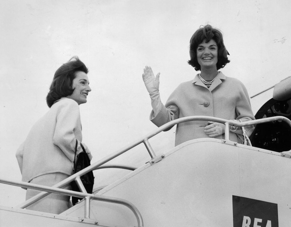 Jackie Kennedy (1929 - 1994), wife of president John F Kennedy, boards a BEA aeroplane at London airport