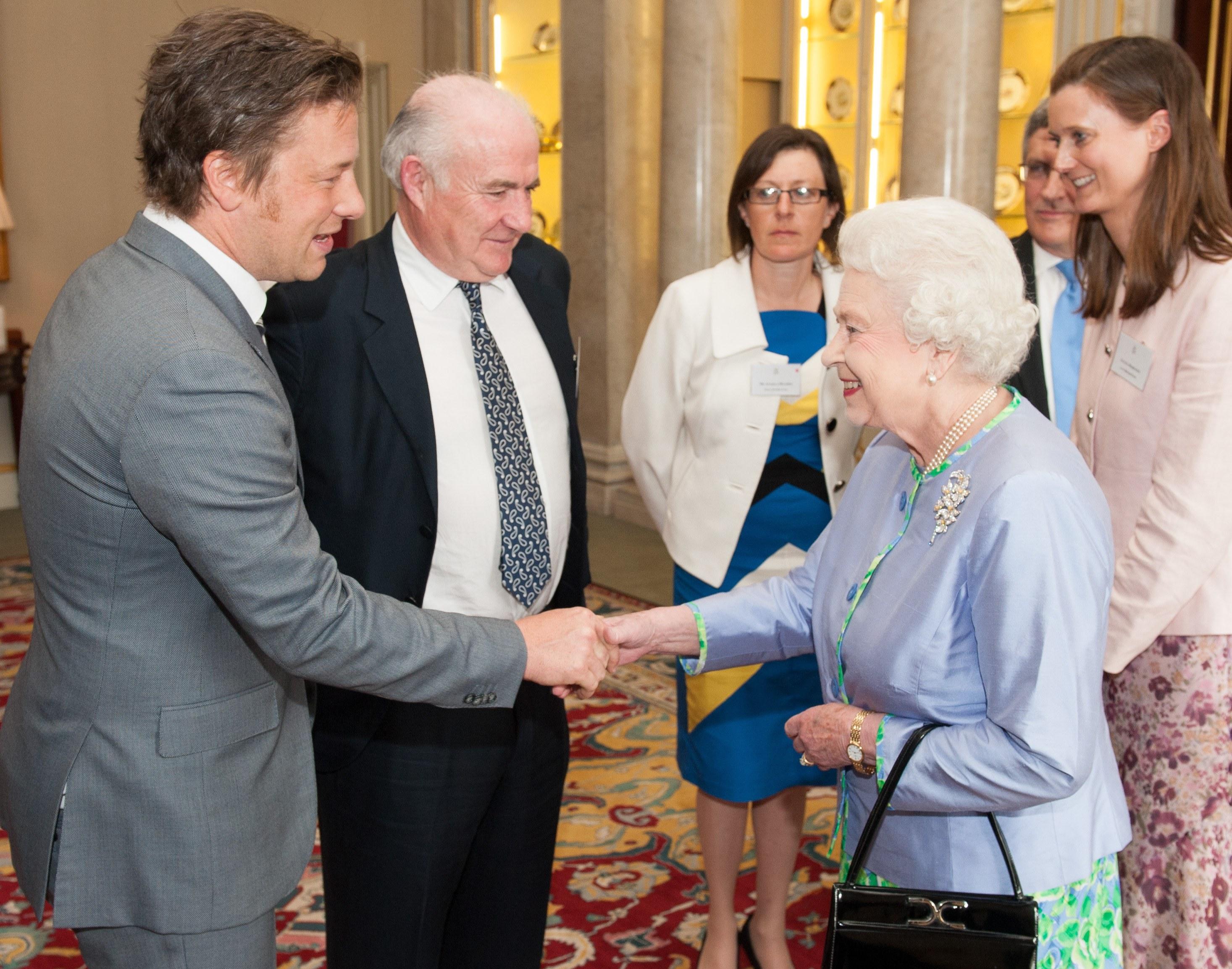 Chef Jamie Oliver shakes hands with Queen Elizabeth