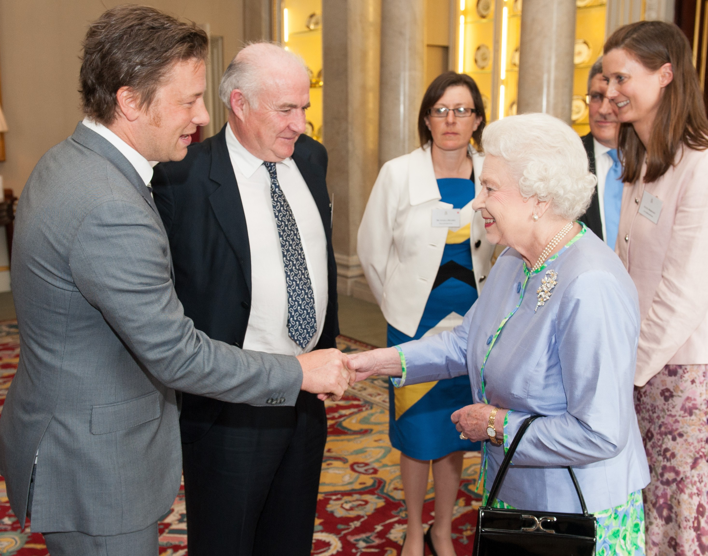 Chef Jamie Oliver shakes hands with Queen Elizabeth