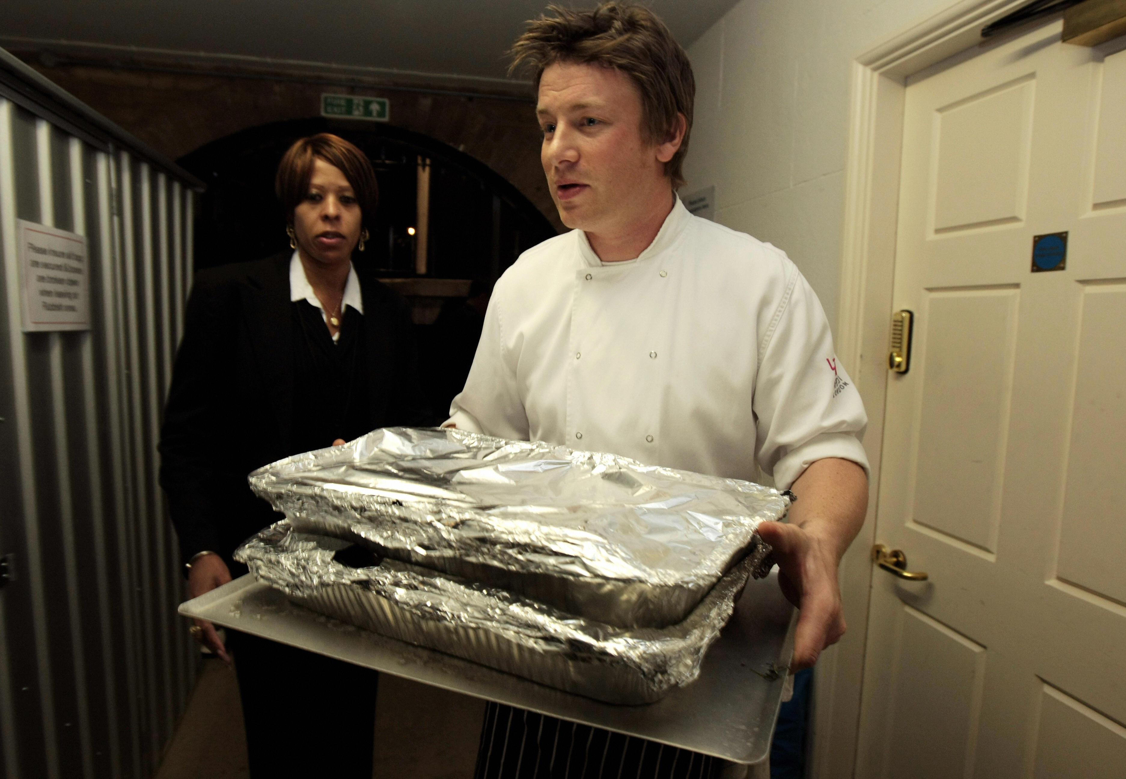 British celebrity Chef Jamie Oliver carries food