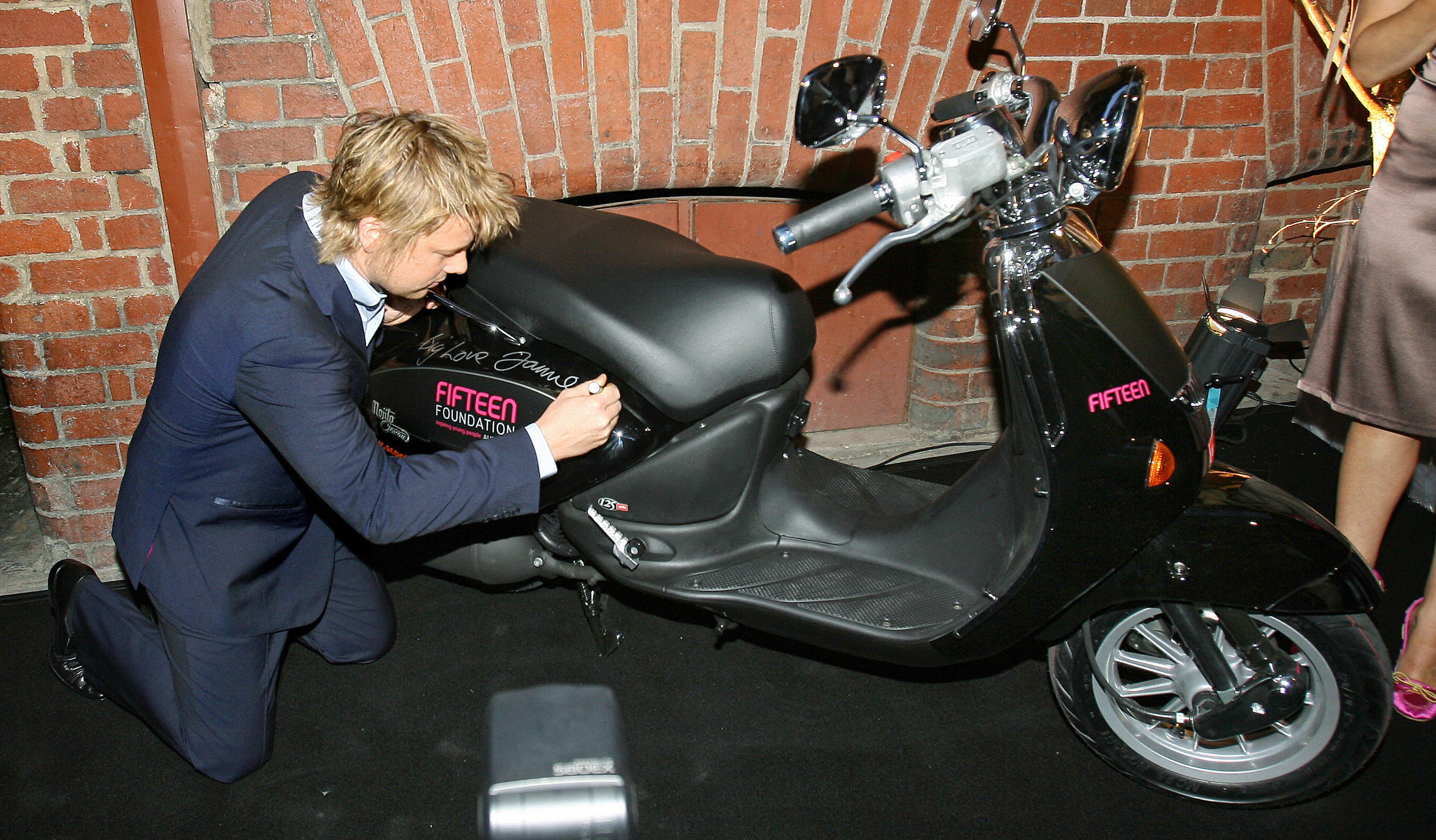 British celebrity chef Jamie Oliver signs a moped