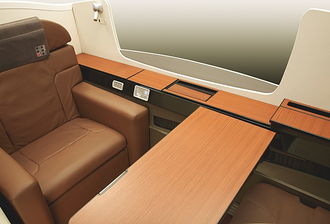 Japan airlines first class brown leather recliner seat.