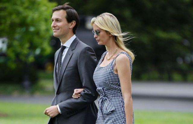 Jared Kushner and Ivanka Trump make their way across the South Lawn.